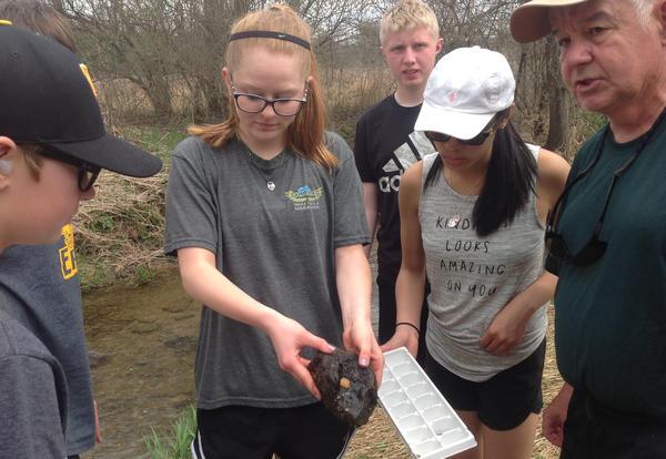 D140 Students Release Trout into Kinnikinnick Creek
