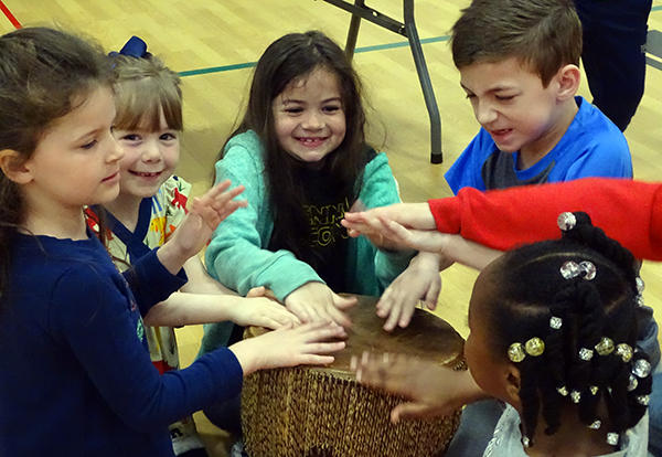 students playing the drum