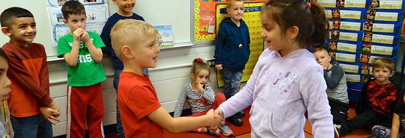 two students shaking hands