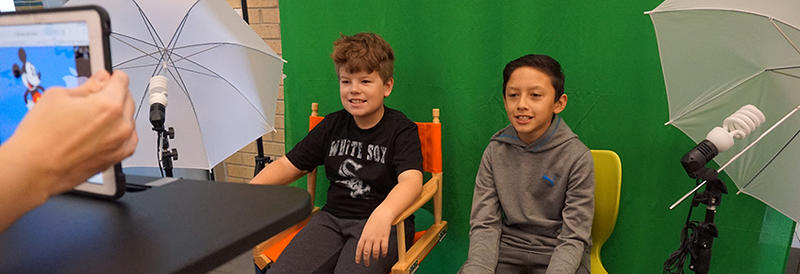 two students doing morning announcements