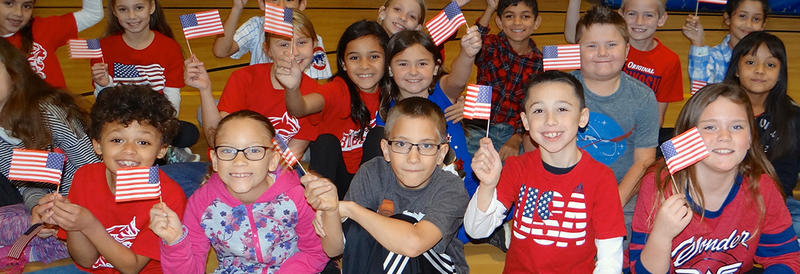 smiling students with american flags