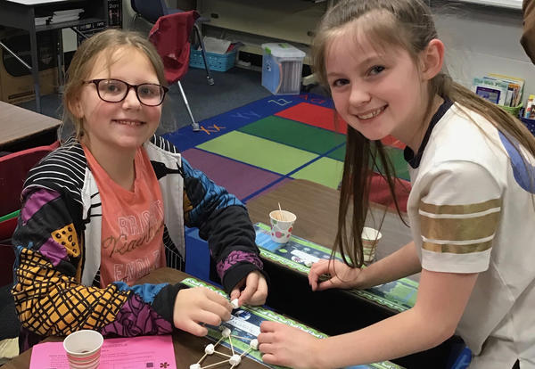 two smiling students at STEAM night