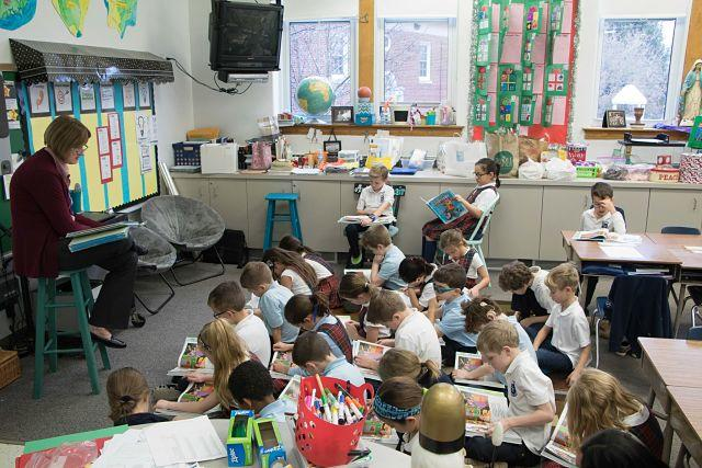 Teacher reading to students in class