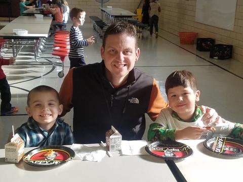 Principal Stabler eating with two boys