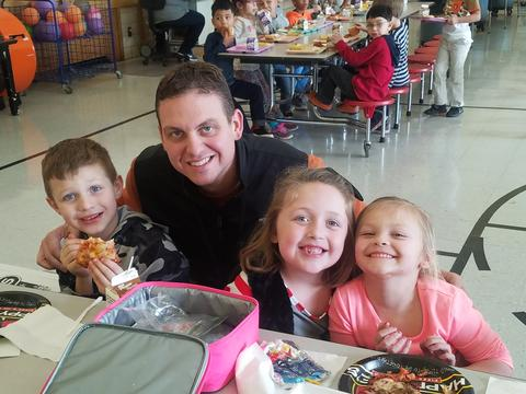 Principal Stabler with three students