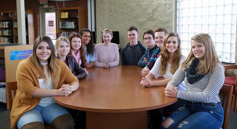 Illinois State Scholars sitting around table