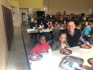 Principal Stabler eating with two students
