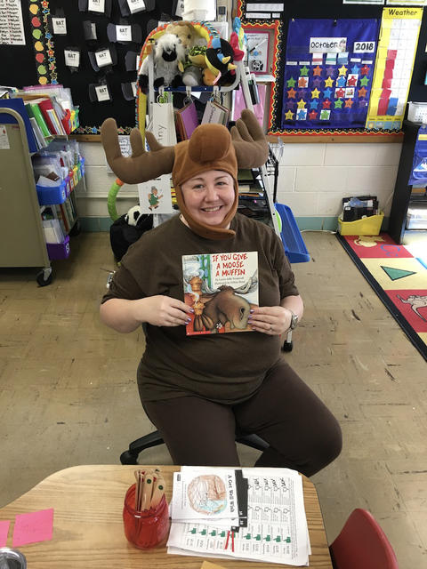 "Teacher dressed as a Moose reading ""If you give a Moose a Muffin"""