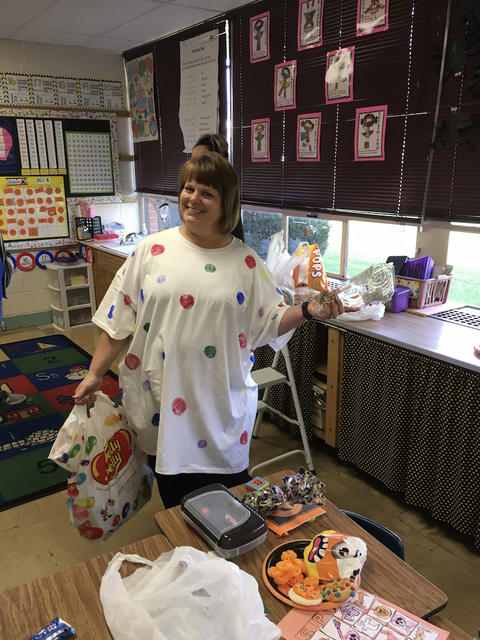 Teacher dressed in polka dots