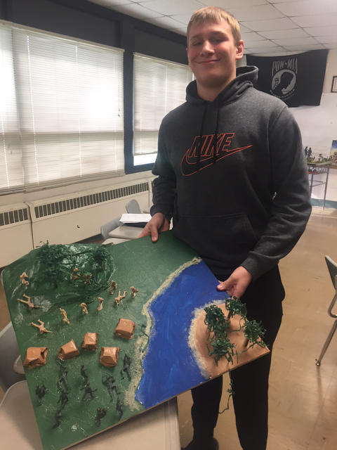 Male student with history project
