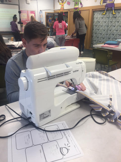 Male student sewing