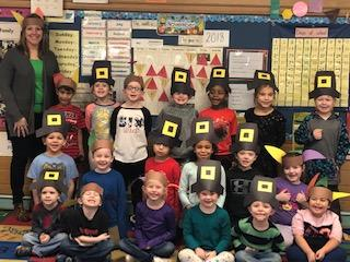 Mrs. Hodge and her class wearing Pilgrim hats