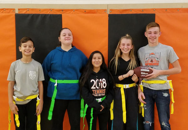 Five Central Students wearing flag belts