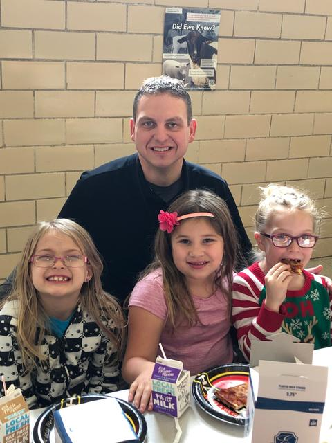 Principal Stabler with three female students