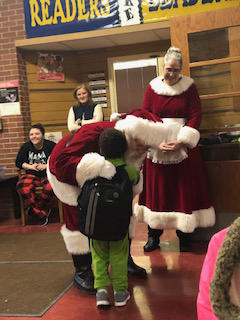 Mr. & Mrs. Claus visit students at Belle!