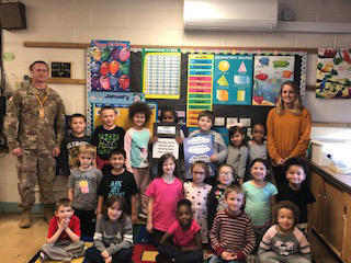 Miss Buerk's 1st Grade Class and Chief Warrant Officer Eble learn about Responsibility