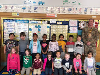 Mrs. Martinez's Kindergarten class with Chief Warrant Officer Greg Eble