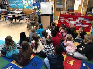"Chief Warrant Officer Greg Eble reads a book about ""Responsibility"" to Mrs. Yarger's 1st Grade Fish Class"