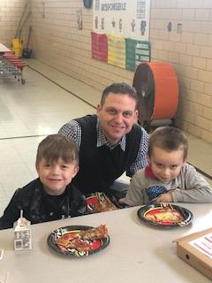 Mr. Stabler enjoying pizza in lunchroom