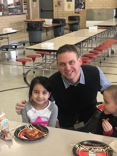 Principal Stabler with two female students in lunchroom