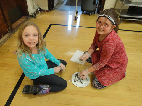 Two female students with owl pellets