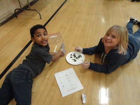 Two Irving 3rd graders with owl pellets