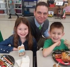 Principal Stabler with two Belle Students eating pizza