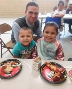Principal Stabler with male and female Belle students eating pizza