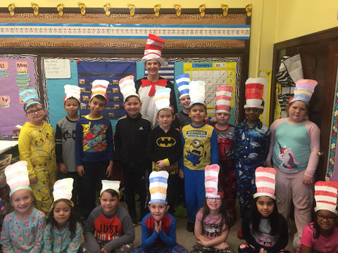 """Mrs. Baney dressed as """"Cat in the Hat"""" with Irving Students"""