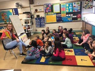 Belle 1st Grade listens to Dr. Seuss Stories read by teacher