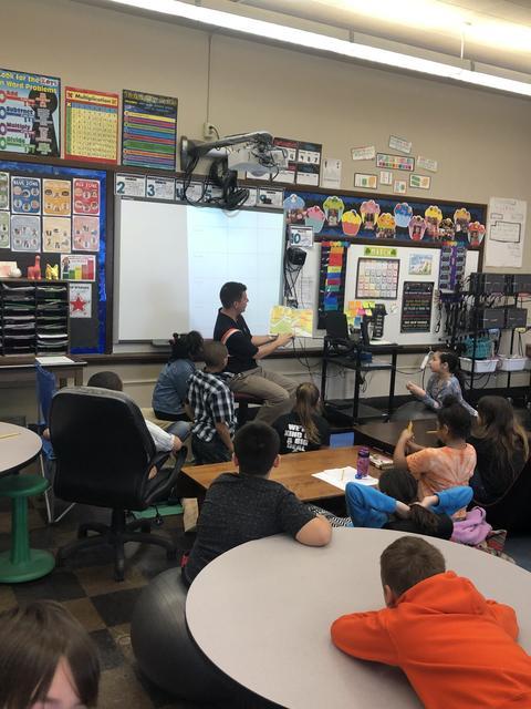 Principal Anderson reading to classroom