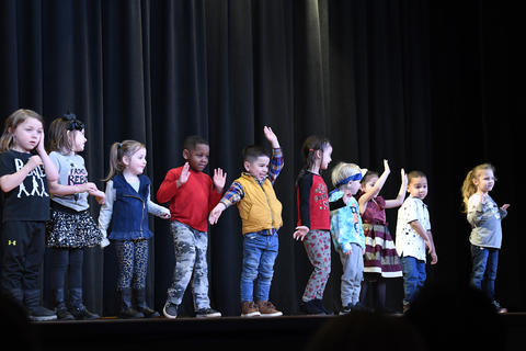 Lyle Pre K Students performing on stage