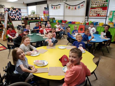 Belle classroom students eating popcorn