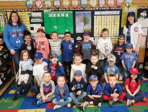 Mrs. Price's classroom students wearing baseball uniforms