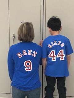 Mrs. Jackson and 1st grade student wearing baseball shirts