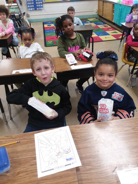 Two Belle Students eating popcorn