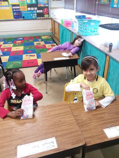 Two Belle Alexander students eating popcorn