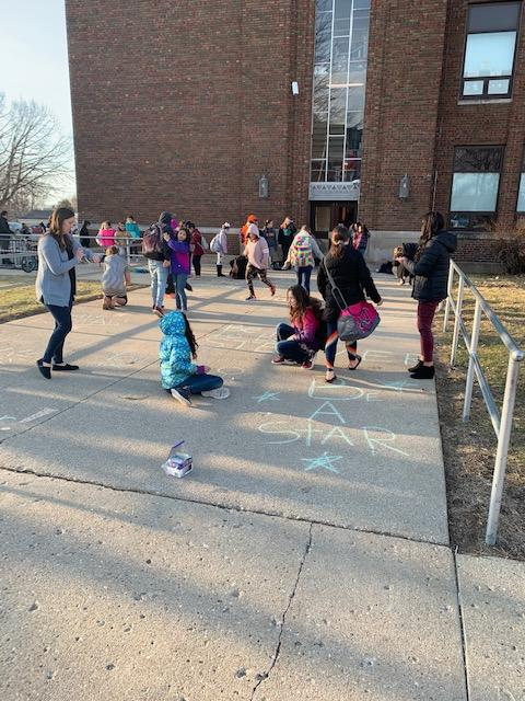 Central Students and Staff on Central playground with chalk messages