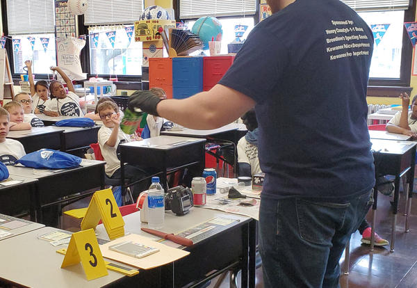 Kewanee Police Department employee in Irving classroom with students