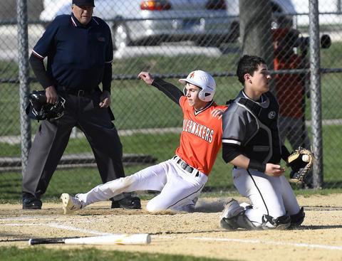 Photo of KHS Baseball player sliding into base