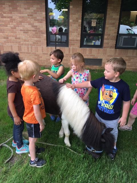 5 Lyle preschoolers with a pony