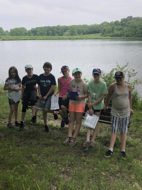 Group of Irving students pictured in front of Lake at Johnson's Park