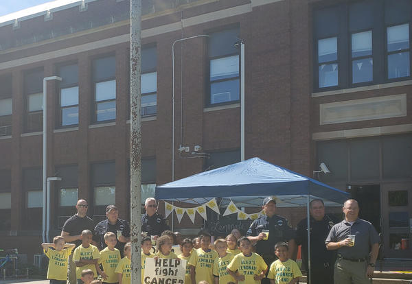 Kindergarten and Belle Summer School Students in front of Lemonade Stand with Kewanee Police Officers