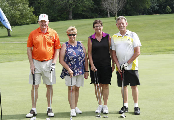 Photo of Tom & Jo Miler and Christine & Richard Downs with golf clubs