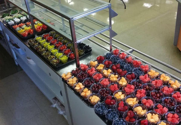 Photo of fruit bowls lined up in serving line