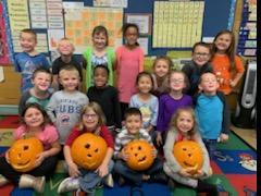 Mrs. Hodge's Kindergarten class with pumpkins