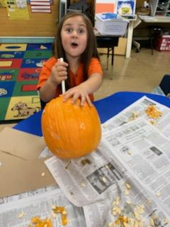 Belle student carving a pumpkin