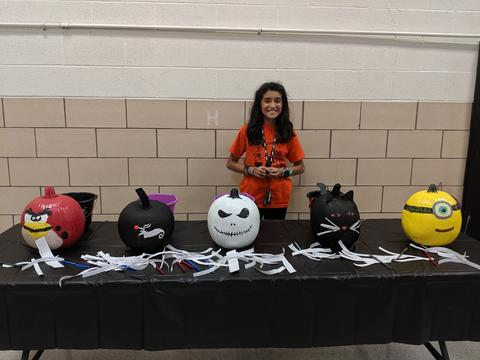 Builders Club member with painted pumpkins