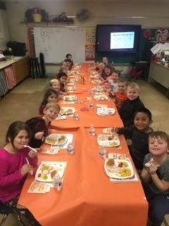 """Ladybug"" Classroom eating at long table"