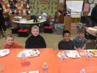 "Four ""Ladybug"" classroom student eating"